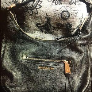 Michael Kors black leather purse.